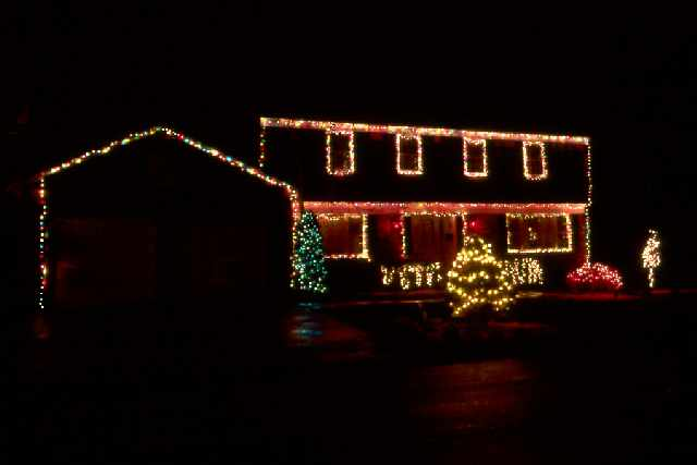 Lights around the four top windows and just under the roof, but there is a  big void on the east side of the house. This was corrected in 2001.  Christmas ... - Christmas Lights 2000